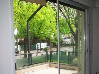 Serramenti in alluminio bianco apertura scorrevole installata a Brescia